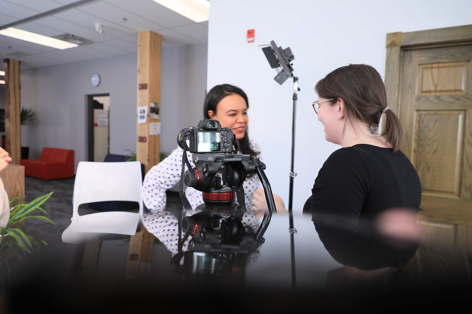 Yuded and Rachel filming for our student interviews